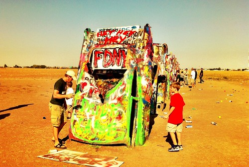 "Spray-Painting at Cadillac Ranch - Amarillo, Texas • <a style=""font-size:0.8em;"" href=""http://www.flickr.com/photos/20810644@N05/8142748041/"" target=""_blank"">View on Flickr</a>"