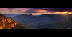 The Glowing 3 Sisters || KATOOMBA {{EXPLORED}} (rhyspope) Tags: new pink blue sunset orange cliff 3 mountains yellow rock wales sisters photoshop sunrise landscape golden three high mt dynamic stitch pano south scenic australia bluemountains tourist panoramic mount valley nsw threesisters aussie solitary range jamison hdr katoomba 3sisters leura escarpment mtsolitary echopoint jamisonvalley rhyspope