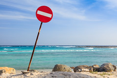 Wrong Way (enfi) Tags: ocean sea beach water sign clouds way landscape rocks waves symbol resort aruba wrong stop caribbean