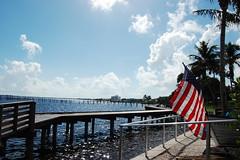 Downtown Flag (ethanfeck) Tags: nikon nikond40 florida america flag sky ocean