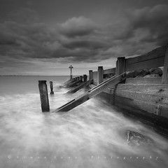 rush (~Ventnor~) Tags: mono black white leefilters hitechfilters long exposure misty water tide sea shore coast coastal seaside groyne harbour defence seascape cloud monochrome rush canon7d sigma1020mm rock wood wooden