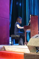 Pianist (oz_lightning) Tags: asia china huzhutuautonomouscounty people qinghai sonyrx100iii weiyuantown concert culture interior weiyuanzhen chn