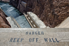 keep off wall. hoover dam. 2014. (eyetwist) Tags: eyetwistkevinballuff eyetwist danger keepoffwall hooverdam boulderdam hoover dam boulder coloradoriver colorado river arizona nevada mojavedesert mojave desert reclamation reservoir powerplant electricity generating power highdesert nikond7000 18200mmf3556gvrii plugin processed postprocessed nik color efex nikcolorefex vertigo high longwaydown bridge lakemead lake mead american west type typography typographic lettering stencil concrete guardrail