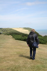 Striding Out (My photos live here) Tags: hastings east sussex england grass cliffs tops english channel sea canon eos 1000d