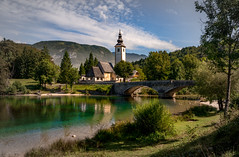 Postcard View of Bohinj Lake (Bernd Thaller) Tags: ribevlaz slovenia slowenien bohinj lakebohinj lake shore bridge church architecture landscape village outdoor daylight postcard