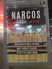 Narcos Bus Shelter Pile O Money AD 5217 (Brechtbug) Tags: narcos tv show bus stop shelter ad with piles slightly singed real fake money or is it 2016 nyc 09102016 midtown manhattan new york city 49th street 7th ave st avenue moola bogus