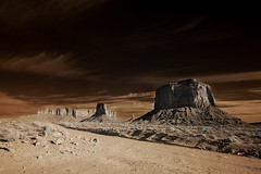 Monuments in Infrared (Bill Gracey) Tags: road travel vacation arizona tourism nature composition rocks infrared dirtroad monuments iconic formations rockformations scenry buttes monumentvalleytribalpark theoldwest