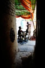 Man at Work - Durga Puja - Kolkata (Rajesh_India) Tags: india west religious god kali religion goddess idol ritual indians utsav kolkata bengal calcutta durga 2012 durgapuja godess bengali ghat westbengal bangali kumartuli kumartoli kumortuli
