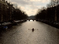 Amsterdam rowing (Germn Vogel) Tags: bridge holland water amsterdam river boat canal europe horizon row netherland channel westeurope