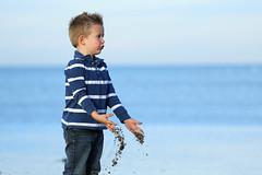 At The Baltic Seaside (tagdrei) Tags: blue boy sea portrait playing beach smiling strand meer alone head balticsea blond blau ostsee junge lcheln spielen kopf allein canonef70200f4isusm canoneos5diii