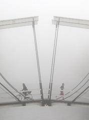 Misty Morning in Amsterdam (lambertwm) Tags: bridge mist holland amsterdam bicycle fog thenetherlands meeting crop hermitage runner bicyclette fietsen jogger encounter mistig fietsers ophaalbrug nieuweherengracht ontmoeting hardloper