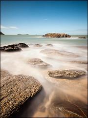 (David Panevin) Tags: longexposure sky bw seascape beach water clouds landscape rocks waves australia olympus queensland e3 cairns trinitybeach sigma1020mmf456exdchsm bwnd110 davidpanevin