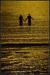 kitschbeach (RTarluche) Tags: ocean sunset shadow sea love beach water silhouette yellow thailand couple asia postcard lovers kohsamui romantic kosamui gulfofthailand