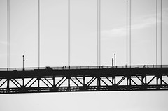 Suspended (N. Maung) Tags: sanfrancisco california bridge bw nikon suspension telephoto goldengate zoomlens 18200mm d7000 nmaung cablestatyed