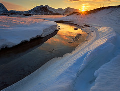 [haukland] (Ennio Pozzetti) Tags: norway beach haukland sunset mood winter clouds ice snow cold river water mountains hauklandbeach