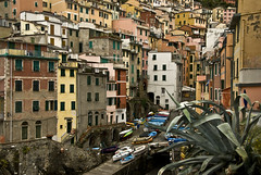 265 - Cinque Terre (kosmekosme) Tags: riomaggiore italy cinque terre cinqueterre houses buildings color colorful colourful windows boats village travel italianriviera architecture fivelands liguria unesco world heritage unescoworldheritagesite cinqueterrenationalpark national park site terraces parconazionaledellecinqueterre parco nazionale delle