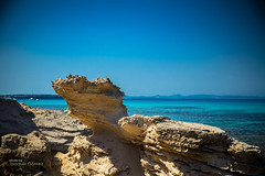 Carved sandstones (Oddiseis) Tags: formentera balearicislands spain tramuntana escaldesantagust sea mediterranean water island ibiza ithak rock stone sandstone nature sky colors coast litoral blue beach shoreline light summer sunny sculpture rocky tamron247028