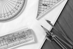 #Back To School (253/366) (AdaMoorePhotography) Tags: backtoschool flickrfriday flickr d7200 105mm 105mmf28 366 black white blackandwhite compass ruler protractor paper book school nikon macro pencil