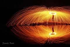 Fire on Lake Nipissing - P9240239 (pamelabeale) Tags: sparks longexposure steelwool lakenipissing rocks water orange night ontario canada lavigne