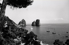 Coast (Halibel14) Tags: sea summer sky blackandwhite bw italy tree mamiya film beach marina landscape boats island photography capri boat photo rocks torre tmax 400 yashica piccola faraglioni saracena 135ef