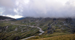Transalpina road in Parang Mountains in Romania (Dragos Cosmin- Getty Images Artist) Tags: road above park morning travel wild summer vacation sky panorama mountain mountains green cars tourism nature beautiful beauty grass clouds season landscape outdoors highlands high highway scenery colorful europe day view natural bright background hill scenic meadow peak nobody scene curvy calm aerial journey valley transportation romania vista environment winding curve carpathians height parang attraction steep bending transalpina massif transfagarasan urdele southerncarpathians sebe parngmountains urdelepass