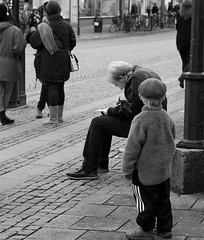 Studying at a bus stop (R A Pyke (SweRon)) Tags: street boy people urban blackandwhite bw man bus reading pentax sweden study stop studying k5 rebro drottninggatan pentaxsmcfa50mm114 sweron