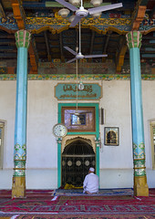 Man Praying Inside Altyn Mosque, Yarkand, Xinjiang Uyghur Autonomous Region, China (Eric Lafforgue) Tags: china travel people clock tourism vertical architecture religious person fan amazing colorful day alone muslim islam faith religion praying chinese indoor mosque barefoot uighur xinjiang silkroad ritual daytime inside colourful uyghur minority anthropology theology ethnicity sociology peoplesrepublicofchina autonomy dayview turkic pratice humanright uygur paintedpole ouigour mirhab colorpicture img1508 ethnicgroup colourpicture xinjianguyghurautonomousregion altynmosque easternandcentralasia turkicethnicgroup araxcin altunmosque towardmecca paintedsealing