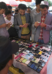 Selling Mobile Phones, Serik Buya Market, Yarkand, Xinjiang Uyghur Autonomous Region, China (Eric Lafforgue) Tags: china travel people man tourism mobile vertical outside person day forsale outdoor muslim chinese citylife communication mobilephone uighur xinjiang silkroad daytime curious uyghur interested minority groupofpeople youngman anthropology telecom ethnicity sociology peoplesrepublicofchina autonomy dayview turkic humanright uygur ouigour checkingout colorpicture img7817 doppi ethnicgroup colourpicture xinjianguyghurautonomousregion groupofpersons easternandcentralasia turkicethnicgroup serikbuya doppilar araxcin