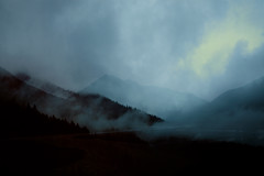 reticent (parfois) Tags: aprilwasteland parfois melancholy landscape fog mountrains scenery trees light shadow filmgrain still solitude immensity quiet peaceful soft colours red reticent canada space rain loneliness alone emotions expression place mountains wilderness bewildering