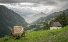 Mountain scene with stone (A_Peach) Tags: alpen berge krnten carinthia mountains rain regen clouds wolken tal valley heiligenblut 52wochenfotochallenge steine