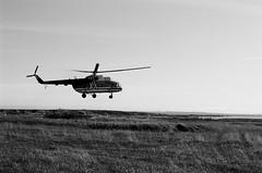 Helicopter from Lovozero to Sosnovka village, Kola land (Iurii & Natali) Tags: helicopter faraway russia north northern sosnovka lovozero kola murmansk tundra fall ilford delta nikon f80 35mm sosnovetz island lighthouse
