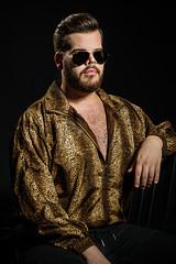 Leopard Fashion Week (Benni 02) (WF portraits) Tags: aut male man model portrait sweater gold hairy beard bear chair piercings nose ear shades rayban tattoo