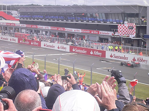Lewis Hamilton takes the chequered flag to win the 2008 British Grand Prix
