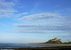 Midsummer Evening On Bamburgh Beach (Louise and Colin) Tags: uk england castle english beach beautiful sunshine clouds seaside rocks midsummer britain eu bluesky medieval explore northumberland shore northumbria british lovely bamburgh seashore sanddunes sandybeach altocumulus thenorthsea bamburghcastle happymemories explored bamburghbeach fortifiedcrag