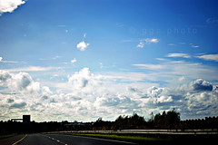 on the road (ggcphoto) Tags: blue trees ireland light sky green grass clouds 50mm perspective ontheroad limerick hedges sonyalpha gettyimagesirelandq12012 horizontalsilhouettes