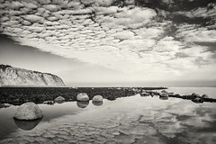 Reflected Sky (Michael Rozycki) Tags: ocean shadow sea sky cliff cloud white black broken water lines rock dark moody horizon reflected