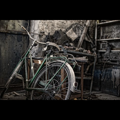 Bike in a workshop (Antonis Liokouras) Tags: color classic abandoned bike bicycle horizontal mystery composition digital vintage cycling industrial transport nobody scene dirty transportation vehicle d700