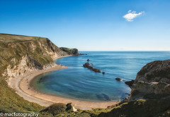 cove............... (4macfotography) Tags: uk blue sea sky cliff cloud beach rock landscape coast crystal cove horizon formation clear dorset vegetation curve jurassic manowar durdledoor platinumheartaward