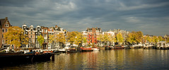 Autumn Colors along the Amstel River, Amsterdam, 2012 (lambertwm) Tags: autumn trees colors amsterdam river boats colours herfst ivy boten crop klimop warehouses amstel kleuren woonboten pakhuizen d700