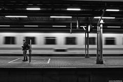 Time passing by (Vlachbild) Tags: street train germany blackwhite europe streetlife trainstation transportation trier rhinelandpalatinate trierhauptbahnhof sonyslta65 carlzeisssal24f20zsony24mmf2distagon