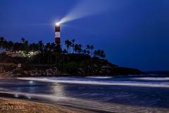 Kovalam Beach by night (light guard) Tags: light lighthouse india beach rock waves ray kerala beam palmtree heat tropical bluehour tropics humidity trivandrum kovalam lightguard jm:rating=4 jm:refined=lart mugginess 00np 00nopeople
