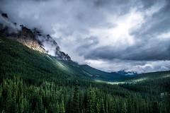 Litt (rezateddy) Tags: canada alberta moraine louise lakemoraine lakelouise clouds cloudy gloomy trees dark mountains rockies