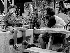 Bliss! (Szoki Adams) Tags: blackandwhite bw cold cute happy sitting legs cone crowd streetphotography spoon delicious shade icecream streetphoto summertime enjoyment picnictable fatherson zonedout blackwhitephotos montrealstreetfestival canong7xmarkii