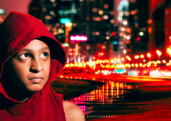A kid in Metro (Ram Iyer Photography) Tags: portrait kid children red city lights cityscape nikon d7100 orange composite ramiyer nikond7100 popular face honey search flickr photoshop edit speedlight sb910 india published advertisement studio twolights