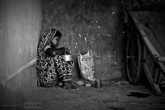 Break Time (Sohail.anwar) Tags: poverty portrait blackandwhite bw woman monochrome wheel portraits photography sitting break poor streetphotography bangladesh dhamrai