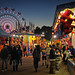 State Fair goers try luck along the midway as the sun sets on another beautiful North Carolina day.