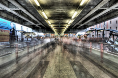 Under The Skytrain (violinconcertono3) Tags: longexposure people urban speed thailand landscapes asia flickr bangkok fineart cityscapes metropolis ghosts skytrain victorysquare masses fineartphotography manic davidhenderson fineartphotographer londonphotographer 19sixty3 19sixty3com