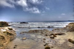 Lagunabeachkimberlyknott (kimberline2011) Tags: ocean california county light sky orange sun abstract beach clouds rocks day waves pacific tide shoreline foam impressionism laguna sailboats