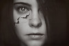 There is a crack in everything, that's how the light gets in. (Lou Bert) Tags: imperfection selfportrait texture crack black white girl woman face halloween self portrait laurenbatesphotography rip broken