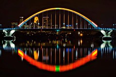 Halloween Glow (Doug Wallick) Tags: bridge orange halloween minnesota skyline reflections river mississippi minneapolis lowry lightroom a55 picmonkey